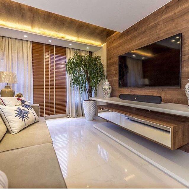 Ideia da Sala decoração super clean almofadas tema natureza e cachepô bistro sobre o rack