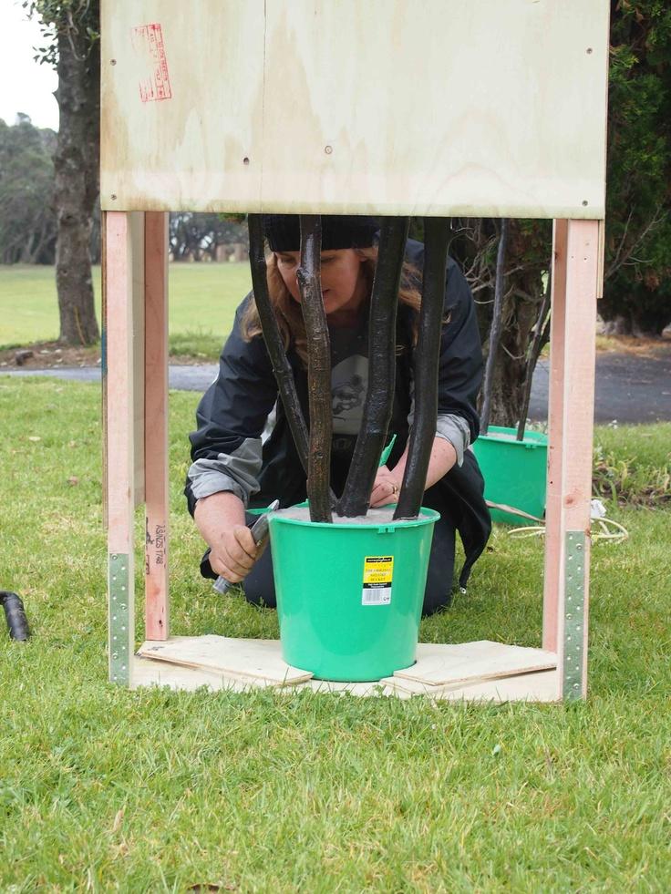 Helen Holmes installing NZ Sculpture on Shore