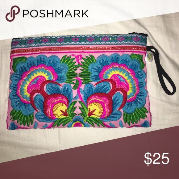 Hmong embroidered floral clutch This bag is from the Hmong tribe in north Thailand. The bag is in used condition. measurements: 10.5 inches wide by 7.5 inches high.  lined with soft black cotton and have a zip to open/close as well as a inside zip pocket. Bags Clutches & Wristlets