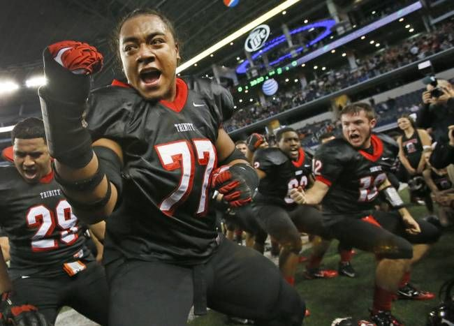 Trinity offensive lineman Patrick Vahe (77) does the haka with teammates after their 42-38 win during the Euless Trinity High School Trojans...