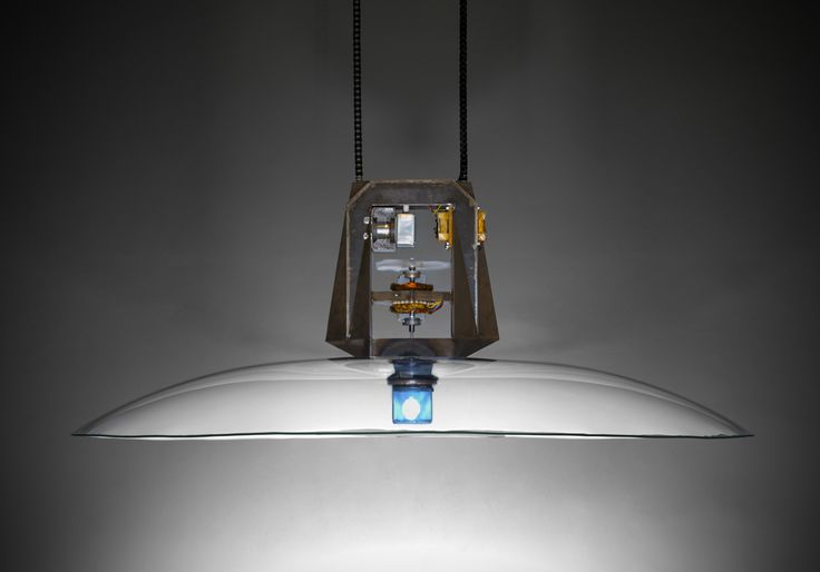 This experimental pendant lighting uses microwave source of energy for its work. Whole unit is precisely designed to fit needs of its technological background, especially it´s proportions came from mathematically calculated shape of waveguide for distribution of energy from the source in to the light bulb. This test unit is made from an old microwave´s electronics and my self, custom made steel sceleton and the rest.