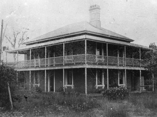 View of the brick house Elsinore at Gayndah Road Maryborough Queensland A large two storey brick building with sash windows, a wrap around veranda and a chimney.