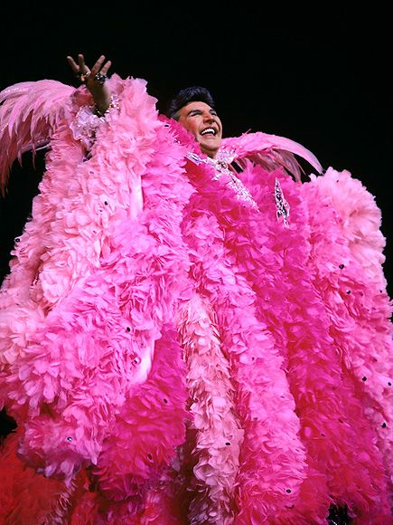 "Liberace stepped on stage in this Hot Pink Ostrich Plume cape and said ""Can You See Me Now""/"