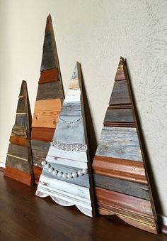 """These pretty planked Christmas trees will look beautiful above your mantel, on your porch bench, propped against/hanging on a wall, or anywhere you can show off this unique piece! Finish: - """"Sparkling"""