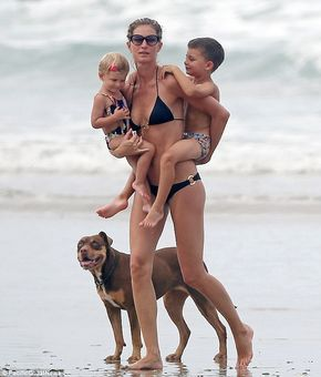 Gisele Bundchen seemed to be having a ball as she frolicked on the beach in Costa Rica with her family http://dailym.ai/1tU1YzK