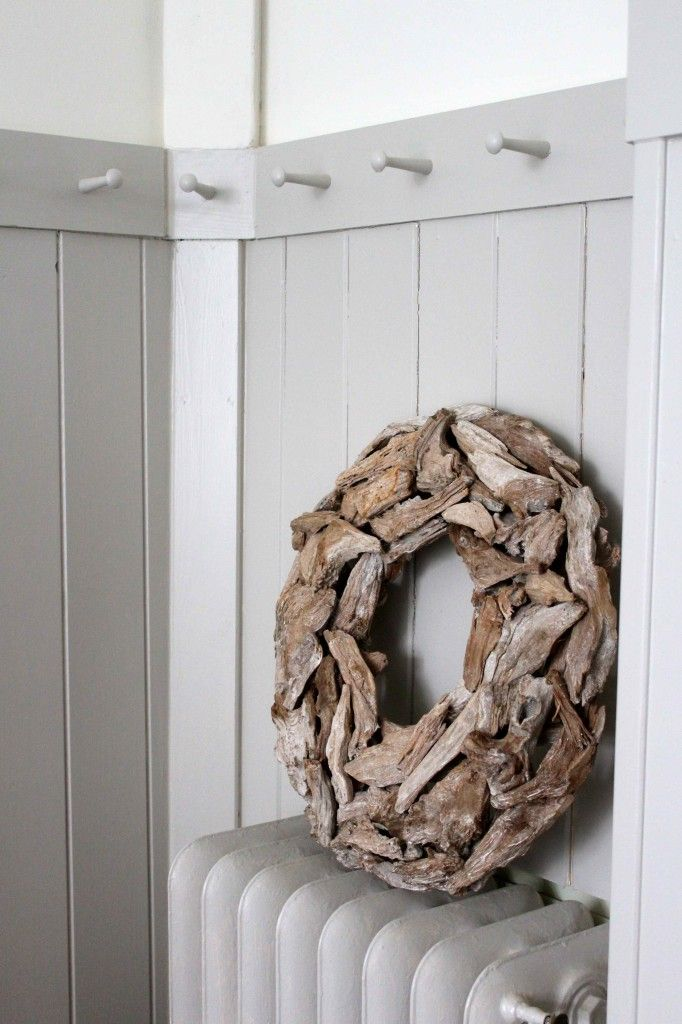 wooden wreath and shaker peg rail