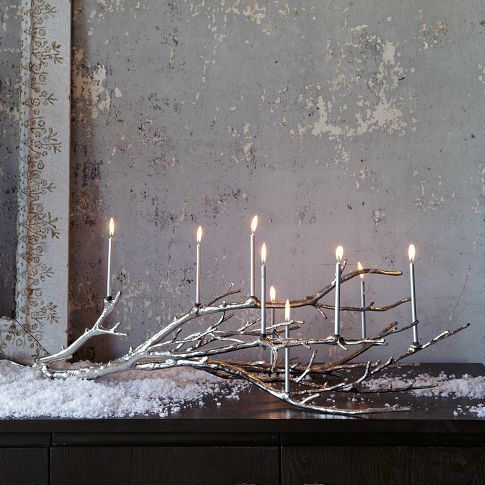 A silver and gold Manzanita branch menorah. The perfect Chrismukkah centerpiece.