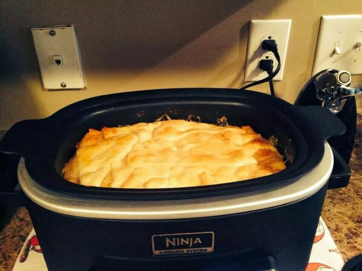 Chicken Pot Pie in Ninja Cooking system. .  1 bag frozen vegi 2 can white chicken 2 can cream of chicken 1 can diced potatoes put in bottom add 1 can crescent roll on top sealed cook 350 for 25 minutes