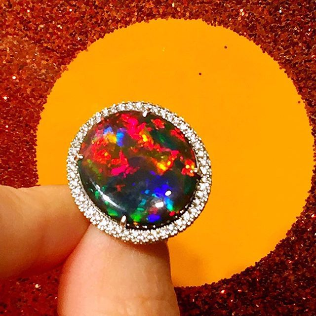 #Red is the rarest hue in an opals play of colour. #Australian #black #opal are the most sought after, this one being a fine example. Now previewing at #bonhams #singapore #preview at #TheRegentHotel #bonhamshk 30-Nov-16 auction of #RareJewelsandJadeite #supergem