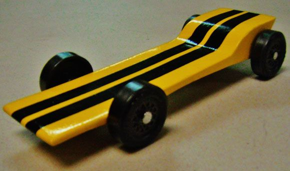 cool pinewood derby ideas for FAST cars.  This would have been valuable info. to me about a month ago when Brad's car took dead last.  Ha!
