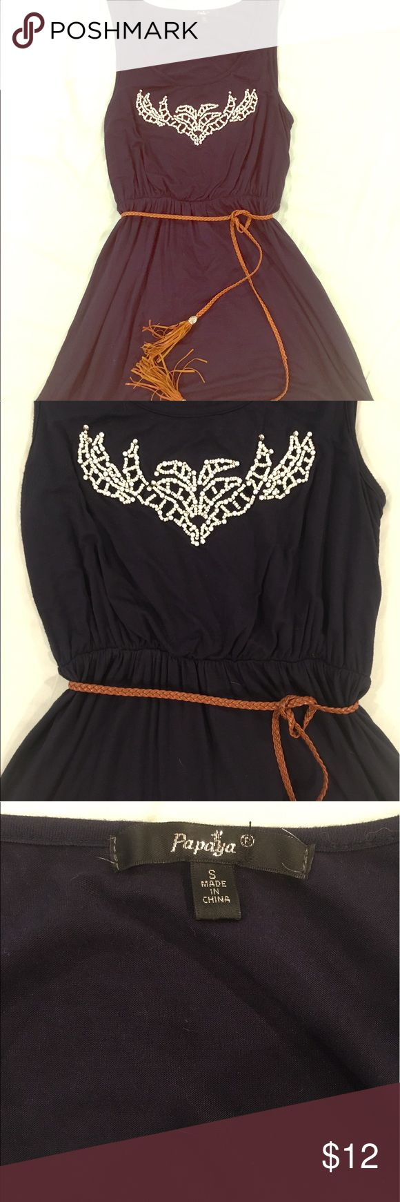 Navy Dress This is a great summer dress! It has white bead work on the front with a brown tie belt!! It looks amazing with cowgirl boots for country concerts or with cute sandals for a date night out!! This is the perfect dress that always looks great!!! Papaya Dresses Mini