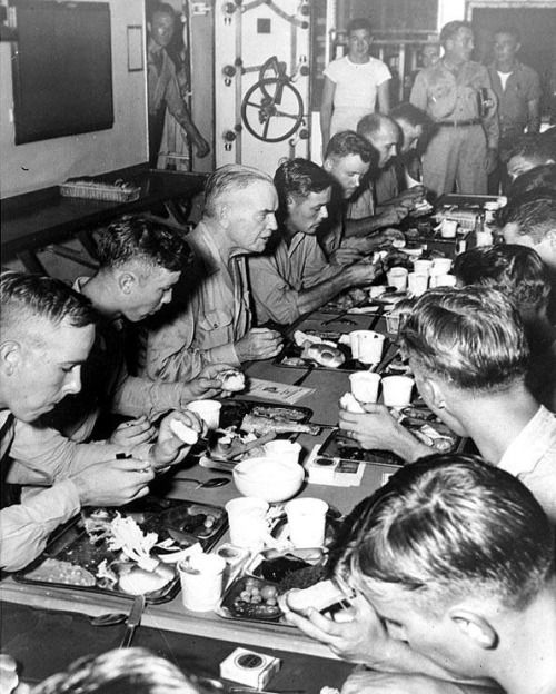 "Admiral William ""Bull"" Halsey having Thanksgiving dinner with the crew of battleship USS New Jersey , his flagship, 30 Nov 1944."