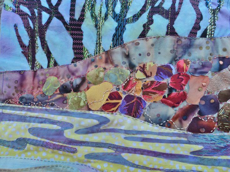 Detail: Trees, rocks & sandy waters. Work in progress. My fabric & stitching choice.  Still stitching.