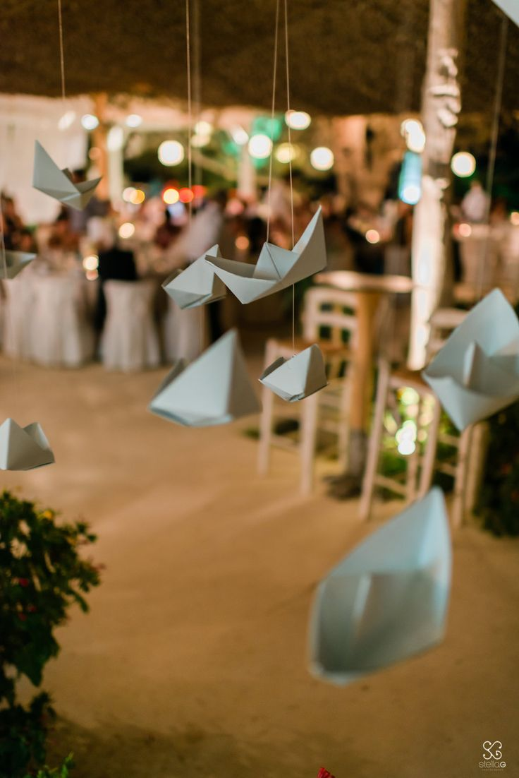 Let's hang a few paper boats!  #paper #boats #hanging #ornaments #decoration #summerwedding #destinationwedding #weddingplanner #dreamsinstyle