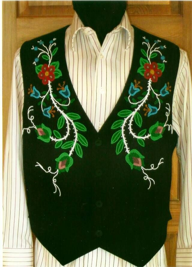 """Christi Belcourt: I designed this for my dad Tony Belcourt but it was beaded & sewn by Brionny Goddard. Its floating around Pinterest at """"Cree floral Men's vest"""" - just in case you see it, you'll know where it originates and who made it."""