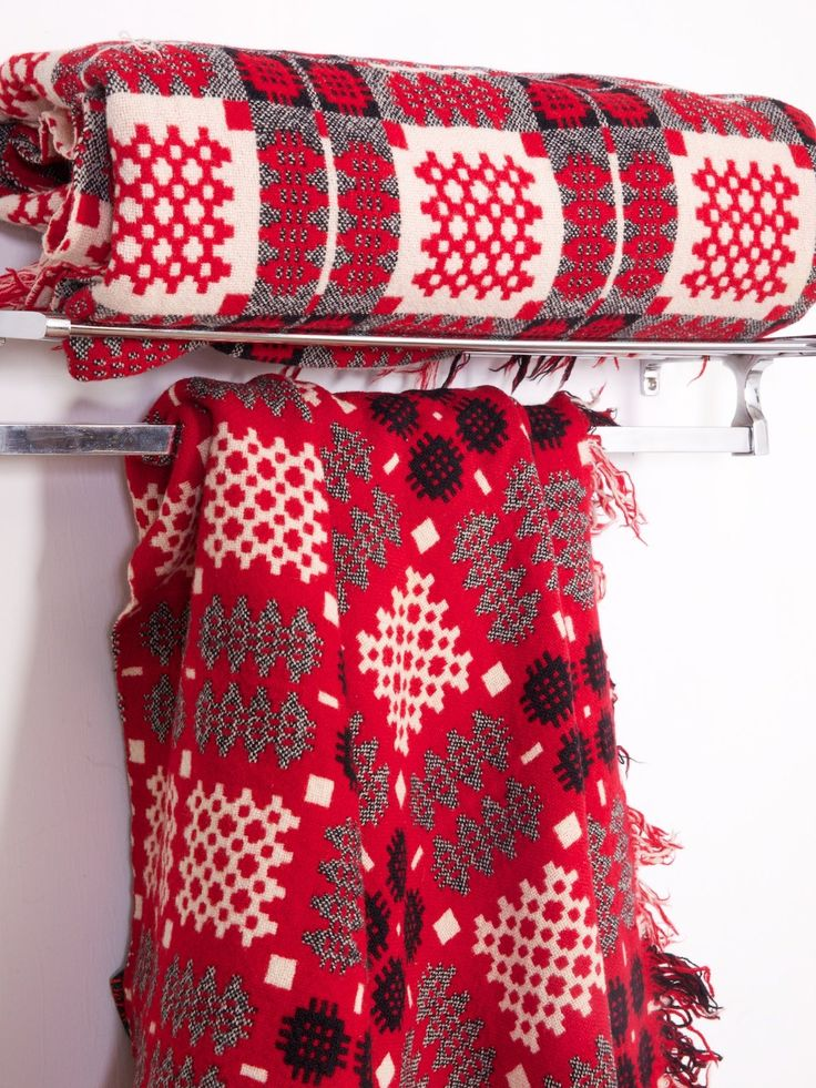 red and grey Welsh blankets