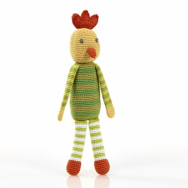 The perfect unisex gift with a gentle rattle inside her green stripey tummy. This crocheted toy was handmade by women in Bangladesh, so slight variations in col