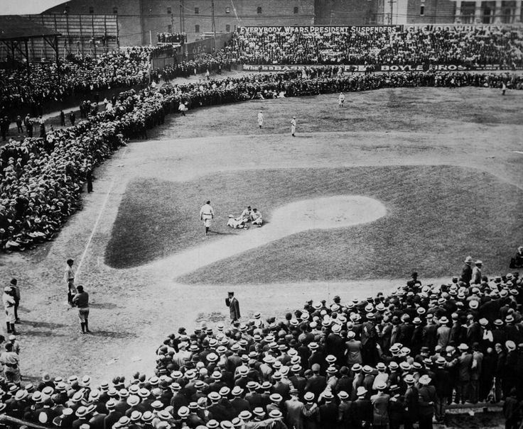 AT THE GAME: Overflow crowd in attendance: up to the base paths and on the outfield. Detroit at Boston game in 1910. Picture may show an injury near the mound.