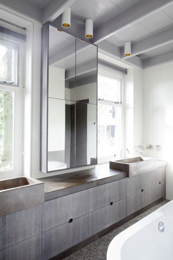 modern bathroom softened with muted palette . nice proportions between mirror and windows . Woonboerderij . Remy Meijers