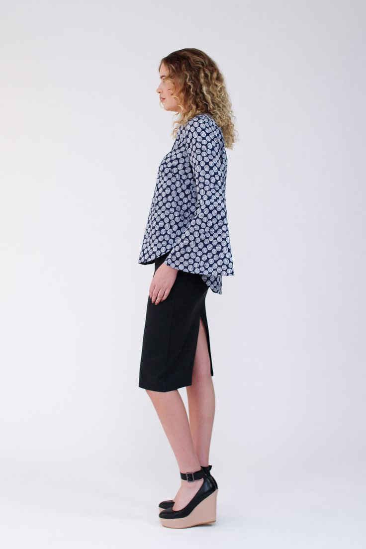 Feminine blouse with statement sleeve cuffs. Pattern features loose fit, french darts, v neckline, curved hemline, and three sleeve options.  Version 1 is a blouse with elbow length sleeves. Version 2 is a blouse with flared sleeves. Version 3 is a blouse with bell sleeves.