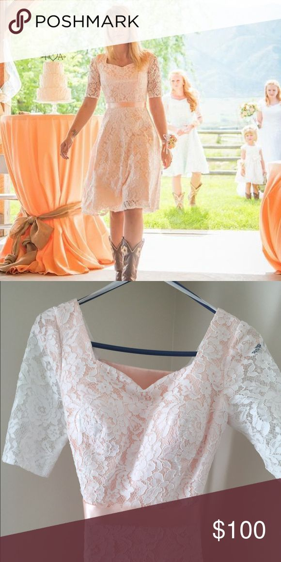 Peach Lace Dress Absolutely gorgeous, peach lace dress with a flattering princess neckline. The corset lace-up in the back provides for size flexibility and lets you show off your curves and waistline! belle bridal Dresses Midi