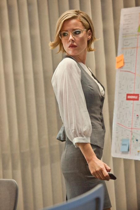 Boss's Kitty O'Neill (Kathleen Robertson) never without her specs, love these pale golden frames on her