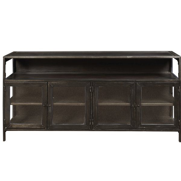 Paying homage to Eric Church's North Carolina roots, this media console from Eric Church's Highway to Home collection can be filled with memorabilia and treasured possessions. With a worn, dark rubbed finish, the credenza features four metal doors with glass inserts and adjustable shelving. Perfect for family room, media room or even dining room!