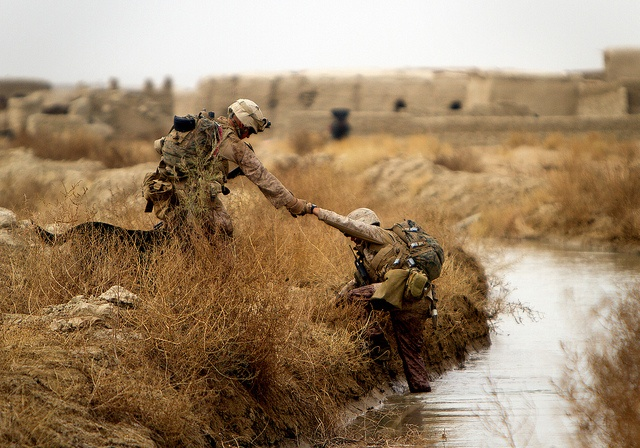 """You voted, and this week's Top Corps Shot comes from Cpl. Alfred Lopez. Lopez was patrolling with 1st Light Armored Reconnaissance Battalion and 3rd Battalion, 3rd Marine Regiment. This was Lopez's first patrol through the canals, and the difficulty of traversing the terrain stood out to him. In fact, on the next patrol, he slipped and went under water, breaking his camera in the process. """"I wanted to be able to share that experience with everyone who reads my stories,"""" said Lopez"""