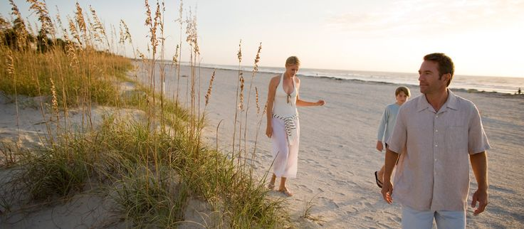 A family walking along the beach Hilton Head Island make some memories to last a life time