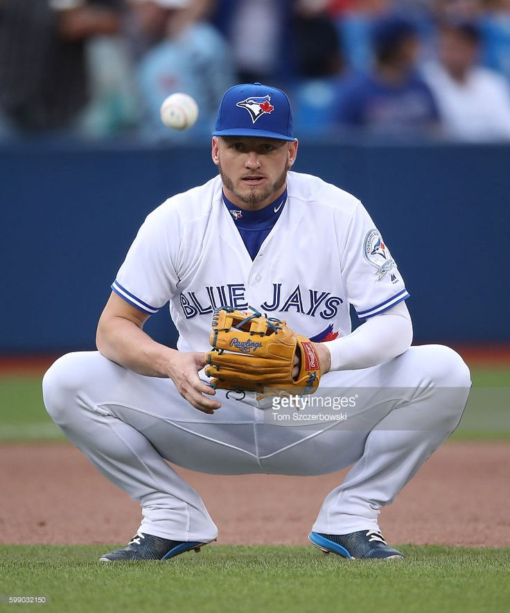 Josh Donaldson #20 of the Toronto Blue Jays takes a grounder as he warms up before the start of MLB game action against the Los Angeles Angels of Anaheim on August 23, 2016 at Rogers Centre in Toronto, Ontario, Canada.