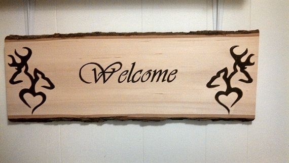 Wood burned welcome plaque with Browning deer and hearts