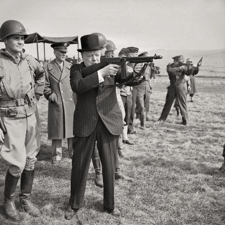 'Winston Churchill fires a Thompson submachine gun alongside the Allied Supreme Commander, General Dwight D Eisenhower, during an inspection of US invasion forces', March 1944
