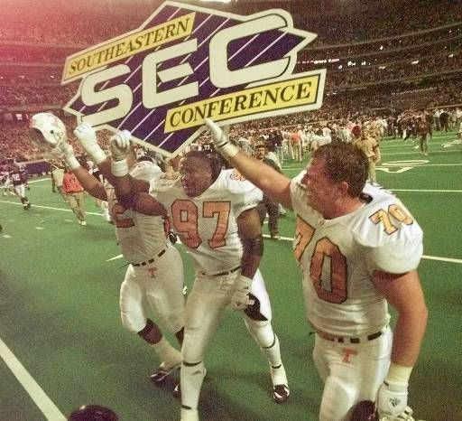 Tennessee players Jarvis Redo (72), Buck Buxon (97) and Trey Teague (70) celebrate their 30-29 win over Auburn in the SEC Championship game at the Georgia Dome in Atlanta on Saturday, Dec. 6, 1997. (AP Photo/Dave Martin)…
