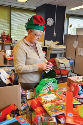 Telus Ambassadors, a group of current and former Telus employees, are busy filling their annual Christmas stockings for charity.