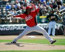Starting pitcher Johnny Cueto of the Cincinnati Reds throws against the Oakland Athletics during a spring training game.  http://www.fansedge.com/Johnny-Cueto-Cincinnati-Reds-3102012-_631047518_PD.html?social=pinterest_mlb_32412_cueto  #MLB  #Reds