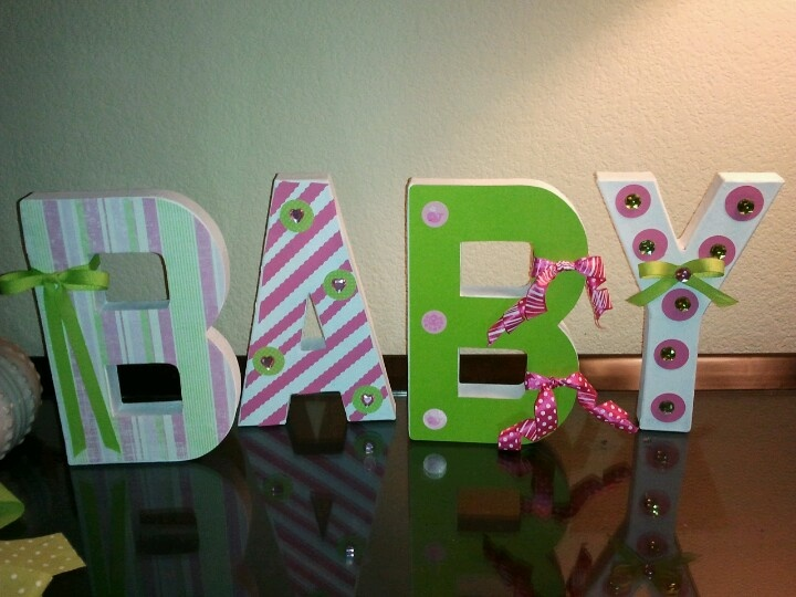 cardboard block letters painted and decorated with scrapbook paper i made these for a friends