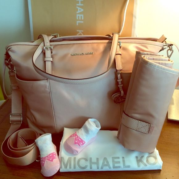 """Gorgeous 100% Authentic diaper bag. Blush color combined with silver hardware.  Comes with changing pad. Paper work and tags are attached.  Perfect new condition.  Long strap is adjustable and detachable as well.  Measurements: L16.5""""/ H11.5"""" Handles: 10"""" Drop Strap: 14""""/22""""  Material Pale Pink/Blush color  Retail price: $298"""