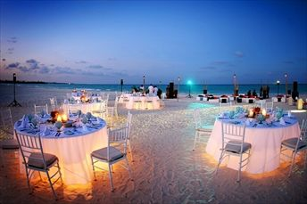 """Love the soft lighting under the tables. How pretty for a night party!"" --- I have to agree, I like the lighting under the tables! If I ever had a beach wedding (which is a possibility considering the man I am going to make marry me is hawaiian) I will totally want the tables to look like this! So dreamy!!"