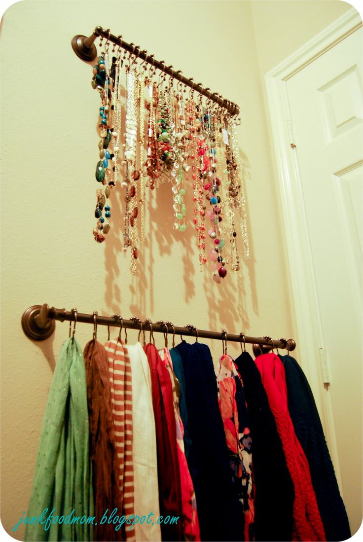 Hang two towel bars in your closet with S hooks for necklaces and shower curtain rings for scarves.