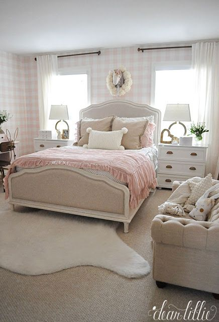 HomeGoods is one of my favorite places to find the finishing touches for a room like this pillows and the throw rug this girl's pink and white bedroom with it's buffalo check wallpaper. (sponsored pin)