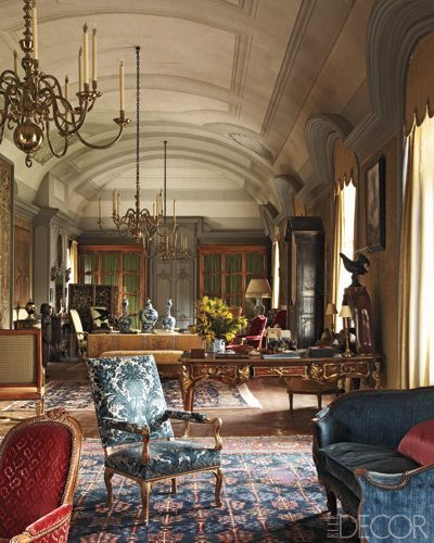 In the drawing room, Baroque chandeliers hang from a ceiling designed by  Mogens Tvede; the furnishings include a Louis XV sofa and a red Louis XVI  bergre, ...