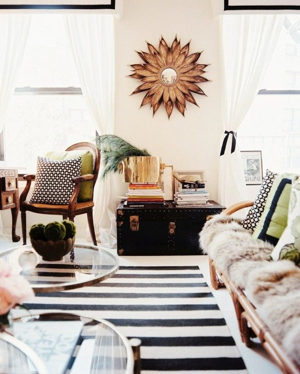 Black and white striped rug in eclectic living room