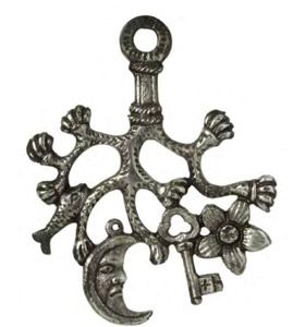 A silver cimaruta ('sprig of rue' amulet from Naples, Italy; intended to protect children, it depicts a fruiting sprig of healing rue, and protective symbols associated with the Roman goddess Diana: silver, a crescent moon, frog, fish and key. (Pitt Rivers Museum)