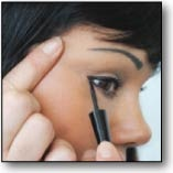 """Add the perfect """"wing"""" to you eyes by applying after completely lining! Hold the applicator wand just outside the corner of your eye in the location you would like your """"wing"""" to stop. Starting at this point, draw the liner in toward the corner of your eye then blend for a subtle look or repeat the process for a more intense eye."""