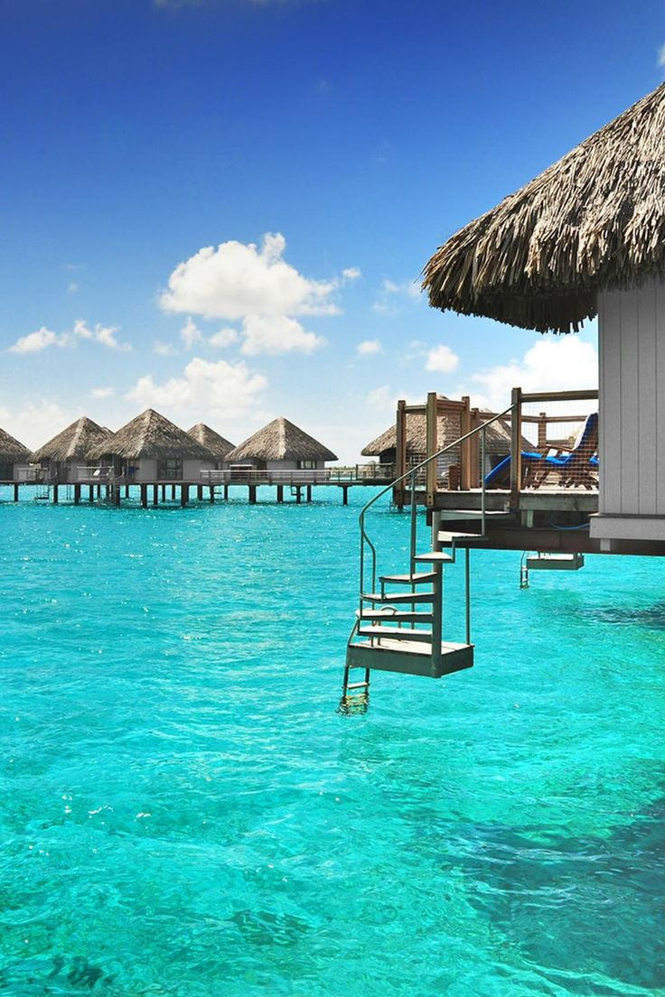 Over water bungalows with steps into lagoon luxury beach villas and bungalows at le meridien