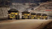 Crude glut, price plunge put oil sands projects at risk