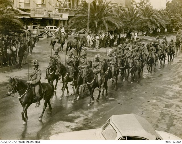 The Maclean troop of the 15th Light Horse parading on their horses through Prince Street, Grafton NSW, between 3rd and 9th April 1938. | Australian War Memorial