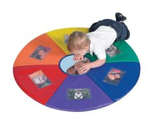 Personalize your kids' sensory activity by inserting their favorite photos in this kid-friendly and colorful mat for playtime. Center mirror attracts baby to look at him/herself.