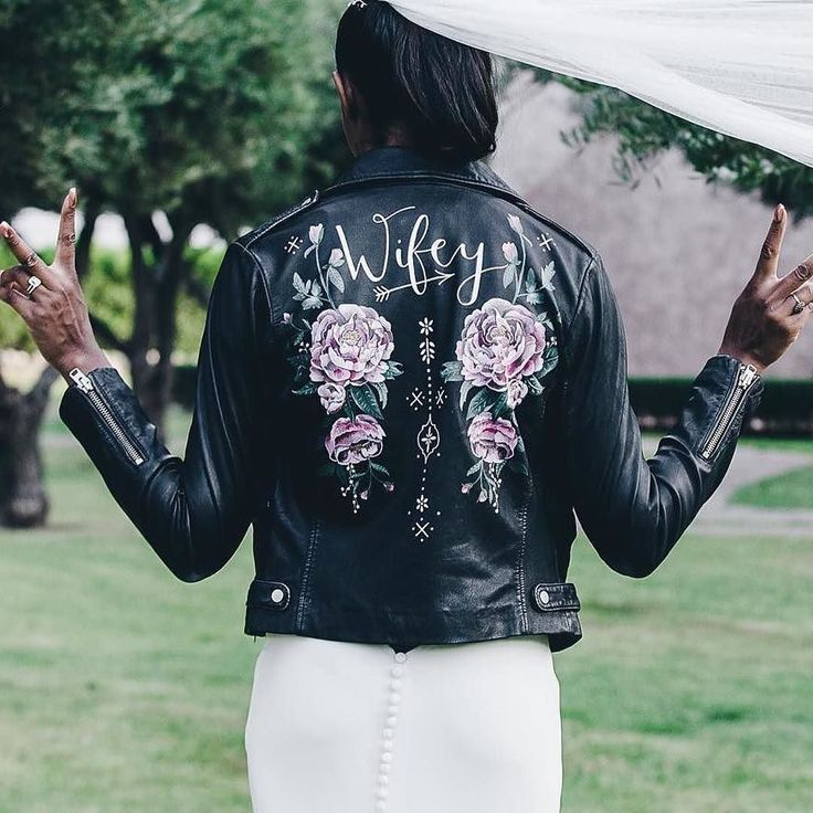 These hand painted leather jackets are EVERYTHING. So beautiful. I want one! Maybe I could tell a little white lie that 5year anniversary is leather (it's not it's three). Would you team your wedding dress with a jacket like this? #Repost @wolfandrosie Here she is the stunning @krisblackett wearing her 'wifey' jacket on her beautiful wedding day marrying her 'hubby' TonyHeld at @palaispaysan and planned by the incredible @boutiquesouk_weddings @anestabroad . #modernbride #style…