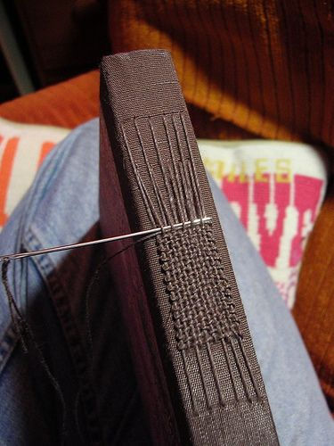 Weaving on the spine of a sketchbook by Figure 5 Studio